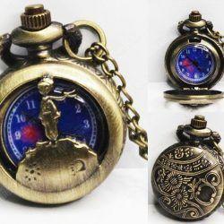 Reloj Libros El Principito Ecuador Comprar Venden, Bonita Apariencia, practica, Hermoso material bronce Color dorado Estado nuevo